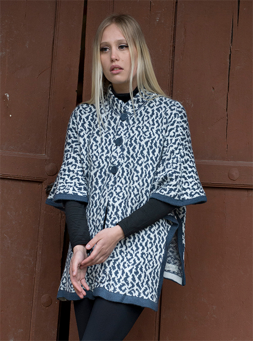 Blue poncho with white patterns and buttons